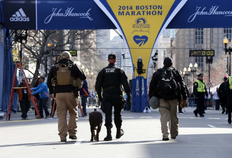 Boston police officers part of the K-9 unit patrol Boylston Street near the finish line before the start of the 2014 Boston Marathon. (Greg M. Cooper-USA TODAY Sports)