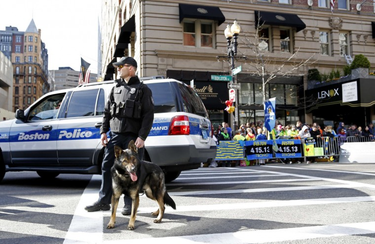 Boston police officers from the K-9 unit patrol Boylston Street near the finish line before the start of the 2014 Boston Marathon. (Greg M. Cooper-USA TODAY Sports)