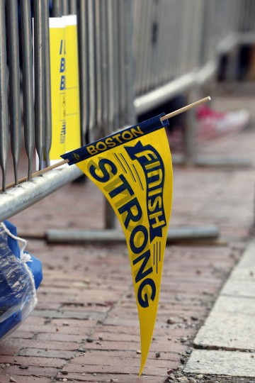 A flag hangs from the barricade on Boylston Street before the start of the 2014 Boston Marathon. (Greg M. Cooper-USA TODAY Sports)