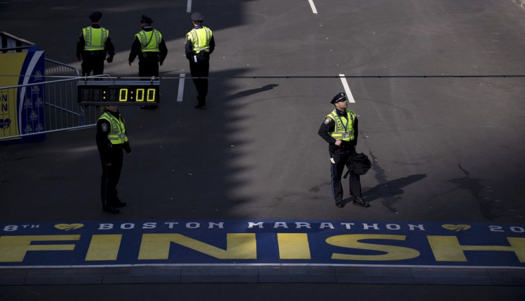 Boston police officers stand along the finish line of the Boston Marathon. (REUTERS/Gretchen Ertl)
