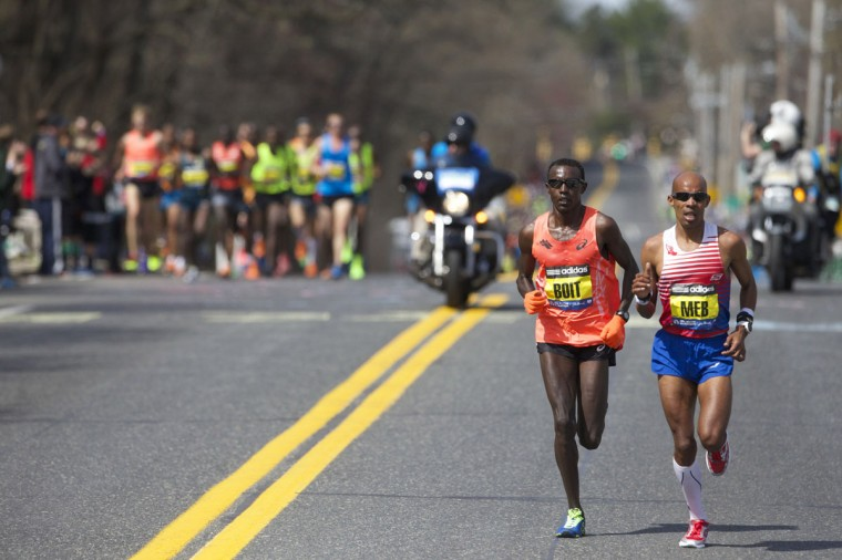 Elite runners Josphat Boit (left) and Meb Keflezighi (right) race during the 2014 Boston Marathon. (David Butler II-USA TODAY Sports)