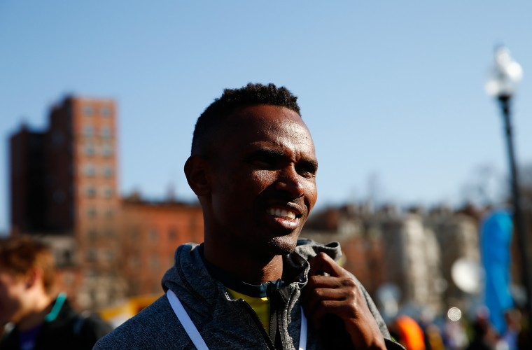 Dejan Gebremeskel of Ethopia waits to accept his award after finishing first in the 2014 B.A.A. 5K on April 19, 2014 in Boston, Massachusetts. (Photo by Jared Wickerham/Getty Images)