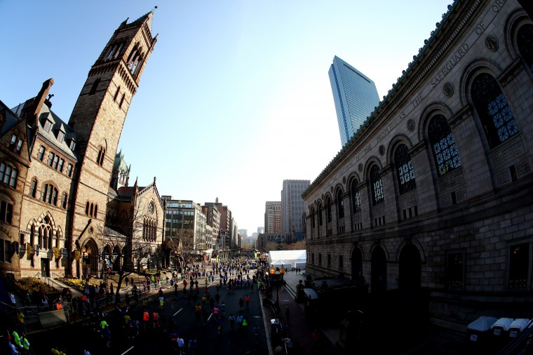 Runners make their way down Boylston Street during the 2014 B.A.A. 5K race on April 19, 2014 in Boston, Massachusetts. (Photo by Alex Trautwig/Getty Images)