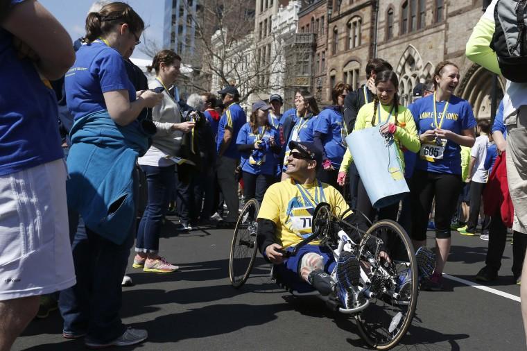 Marc Fucarile, a 2013 Boston Marathon bombing survivor, smiles at supporters after a tribute run down Boylston Street in Boston, Massachusetts, April 19, 2014. (Dominick Reuter/REUTERS)
