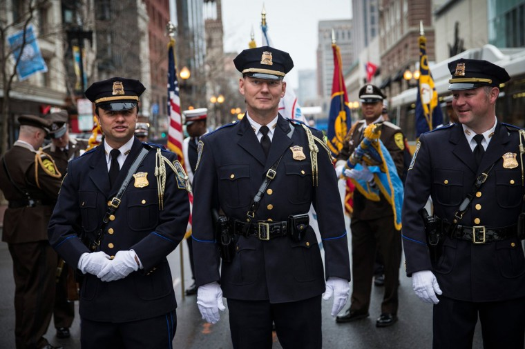 Members of the Boston Police Department practice marching prior to a wreath laying ceremony to commemorate the one year anniversary of the 2013 Boston Marathon Bombing, on April 15, 2014 in Boston, Massachusetts. Last year, two pressure cooker bombs killed three and injured an estimated 264 others during the Boston marathon, on April 15, 2013. (Photo by Andrew Burton/Getty Images)