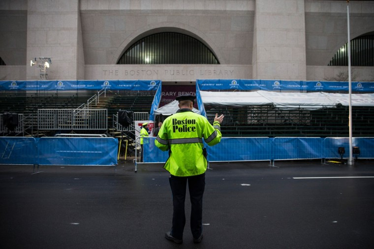 A Boston police officer waves traffic across the finish line of the Boston Marathon on the one year anniversary of the 2013 Boston Marathon Bombing, on April 15, 2014 in Boston, Massachusetts. Last year, two pressure cooker bombs killed three and injured an estimated 264 others during the Boston marathon, on April 15, 2013. (Photo by Andrew Burton/Getty Images)