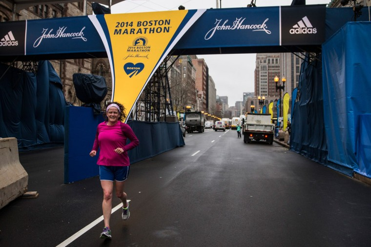 A runner runs underneath the Boston Marathon finish line photo bridge on the morning of the one year anniversary of the 2013 Boston Marathon Bombing, on April 15, 2014 in Boston, Massachusetts. Last year, two pressure cooker bombs killed three and injured an estimated 264 others during the Boston marathon, on April 15, 2013. (Photo by Andrew Burton/Getty Images)