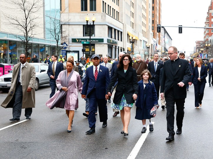 Massachusetts Governor Deval Patrick walks with his wife, Diane, and members of the victims families during a wreath-laying ceremony commemorating the one-year anniversary of the Boston Marathon bombings on Boylston Street near the finish line on April 15, 2014 in Boston, Massachusetts. Last year, two pressure cooker bombs killed three and injured an estimated 264 others during the Boston marathon, on April 15, 2013. (Photo by Jared Wickerham/Getty Images)