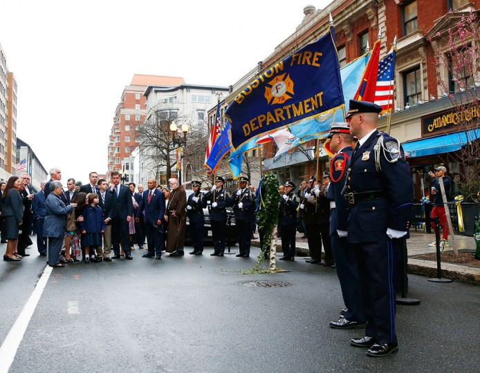 The family of Martin Richard including Bill Richard, along with Boston mayor Marty Walsh, Massachusetts Governor Deval Patrick, and other members of the victims families stand during a wreath-laying ceremony commemorating the one-year anniversary of the Boston Marathon bombings on Boylston Street near the finish line on April 15, 2014 in Boston, Massachusetts. Last year, two pressure cooker bombs killed three and injured an estimated 264 others during the Boston marathon, on April 15, 2013. (Photo by Jared Wickerham/Getty Images)