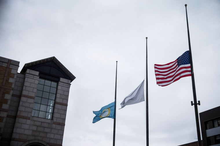 Flags fly at half mast in tandem for a ceremony commemorating the one year anniversary of the 2013 Boston Marathon Bombing , on April 15, 2014 in Boston, Massachusetts. Last year, two pressure cooker bombs killed three and injured an estimated 264 others during the Boston marathon, on April 15, 2013. Neary says she was standing near the site of the bombing before it went off. (Photo by Andrew Burton/Getty Images)