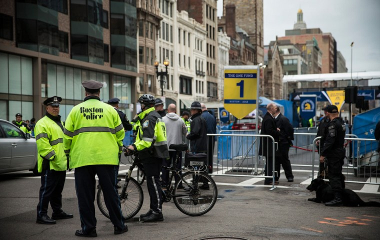 Police officers stand guard near the finish line for the Boston Marathon on the one year anniversary of the 2013 Boston Marathon Bombing , on April 15, 2014 in Boston, Massachusetts. Last year, two pressure cooker bombs killed three and injured an estimated 264 others during the Boston marathon, on April 15, 2013. Neary says she was standing near the site of the bombing before it went off. (Photo by Andrew Burton/Getty Images)
