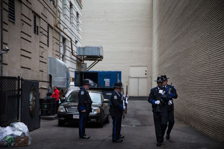 Officers practice marching in unison in an alley in preparation for the one year anniversary of the 2013 Boston Marathon Bombing , on April 15, 2014 in Boston, Massachusetts. Last year, two pressure cooker bombs killed three and injured an estimated 264 others during the Boston marathon, on April 15, 2013. Neary says she was standing near the site of the bombing before it went off. (Photo by Andrew Burton/Getty Images)
