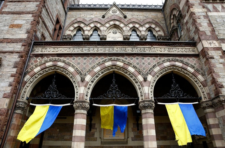 Tattered Boston Marathon flags wave outside the entrance of the Old South Church on Boylston Street near the finish line of the Boston Marathon prior to the flag raising ceremony commemorating the one-year anniversary of the Boston Marathon bombings on Boylston Street near the finish line on April 15, 2014 in Boston, Massachusetts. (Photo by Jared Wickerham/Getty Images)