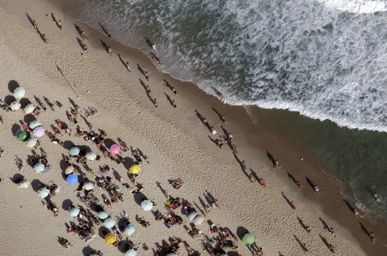 People relax at Ipanema beach in Rio de Janeiro on March 28, 2014. Rio de Janeiro is one of the host cities for the 2014 World Cup soccer tournament in Brazil. (REUTERS/Ricardo Moraes)