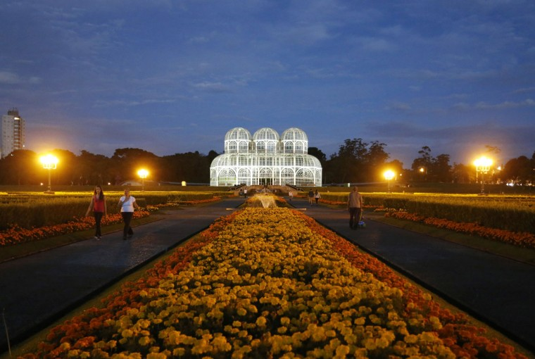 People visit the Botanical Garden of Curitiba, one of the main tourist spots, on March 31, 2014. Curitiba is one of the host cities for the 2014 soccer World Cup in Brazil. (REUTERS/Rodolfo Buhrer)