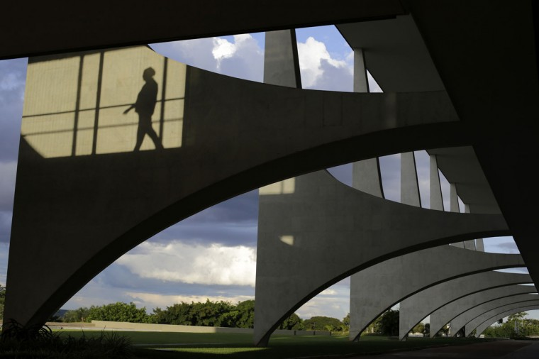 A woman's silhouette is seen at the Planalto Palace in Brasilia on April 2, 2014. Brasilia is one of the host cities for the 2014 soccer World Cup in Brazil. (REUTERS / Ueslei Marcelino)