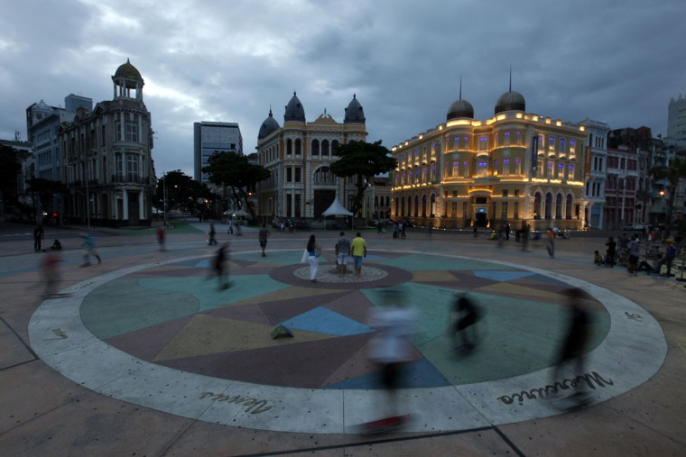 People walk in Rio Branco square located at Ground Zero of the city of Recife, in northeastern Brazil on April 5, 2014. Recife is one of the host cities for the 2014 World Cup in Brazil. (REUTERS/Paulo Whitaker)