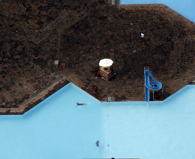People swim at a pool in Sao Paulo, a host city for the 2014 World Cup, on November 28, 2013. (REUTERS/Paulo Whitaker)