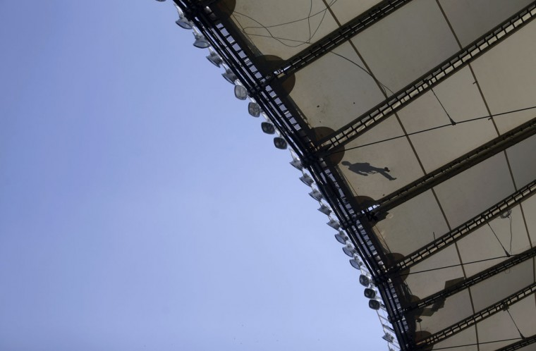The shadow of a worker is seen on the roof of Maracana stadium, which is undergoing renovation for the 2014 World Cup, in Rio de Janeiro. (REUTERS/Ricardo Moraes)