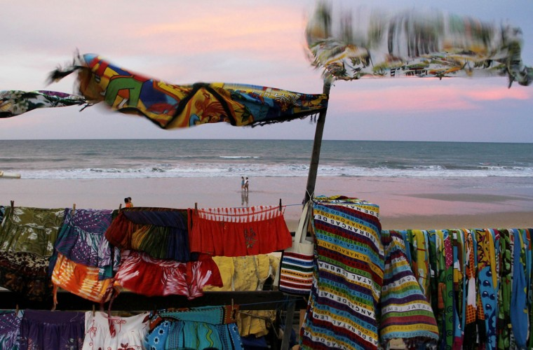 People walk at Ponta Negra beach in Natal, northeastern Brazil, on March 26, 2014. Natal is one of the host cities for the 2014 World Cup in Brazil. (REUTERS/Nuno Guimaraes)