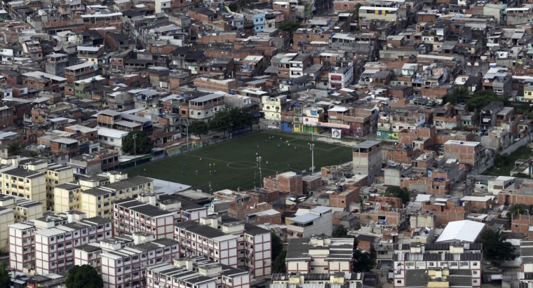 Less than three months before Rio welcomes tens of thousands of foreign soccer fans for the World Cup, the attacks cast new doubts on government efforts to expel gangs from slums using a strong police presence. The city will host the Olympics in 2016. (REUTERS/Ricardo Moraes)