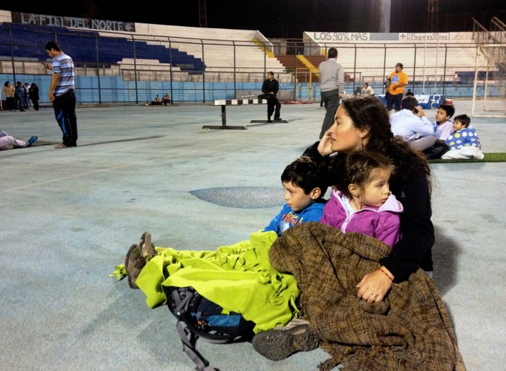Locals take refuge at the city stadium following a tsunami alert after a powerful 8.0-magnitude earthquake hit off Chile's Pacific coast, on April 1, 2014 in Iquique. A tsunami warning has been issued for Chile, Peru and Ecuador, US officials said. The quake struck at a depth of 10 kilometers (six miles), 83 kilometers from Iquique on Chile's northern coast, the United States Geological Survey (USGS) said. (Aldo Solimano/Getty Images)