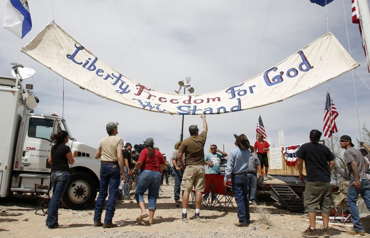 Protesters fly a sign in Bunkerville, Nevada, April 11, 2014. Armed U.S. rangers are rounding up cattle on federal land in Nevada in a rare showdown with Cliven Bundy, a rancher who has illegally grazed his herd on public lands for decades, as conflict over land use simmers in western states. The standoff with the Bureau of Land Management stems in part from Bundy's belief that their right to graze the land predates the federal government's management of it, and that the county and state should ultimately have authority over lands in their boundaries. (REUTERS/Jim Urquhart)