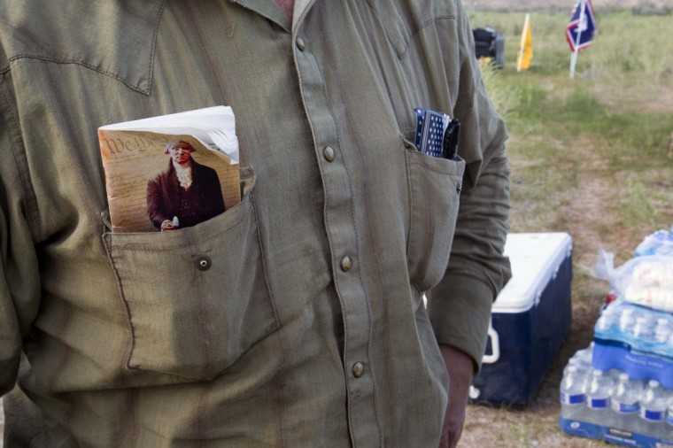 """Ryan Bundy, a son of rancher Cliven Bundy, carries a copy of the U.S. constitution in his shirt pocket during a Bundy family """"Patriot Party"""" near Bunkerville, Nevada, April 18, 2014. The family organized the party to thank people who supported rancher Cliven Bundy in his dispute with the Bureau of Land Management (BLM). The BLM last week called off an effort to round up Bundy's herd of cattle that it said were being illegally grazed in southern Nevada, citing concerns about safety. (REUTERS/Steve Marcus)"""