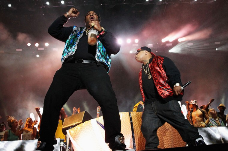 Rapper Busta Rhymes (L) performs with Girl Talk onstage during day 1 of the 2014 Coachella Valley Music & Arts Festival at the Empire Polo Club on April 18, 2014 in Indio, California (Photo by Karl Walter/Getty Images for Coachella)