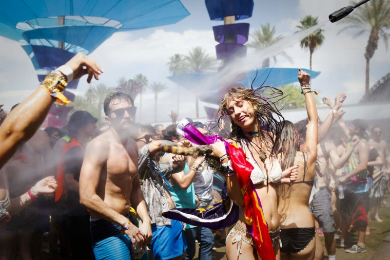 Crowds of people are drenched with water at the Do Lab on the first day of the Coachella Music and Arts Festival in Indio, Calif., on Friday, April 11, 2014. (Bethany Mollenkof/Los Angeles Times/MCT)