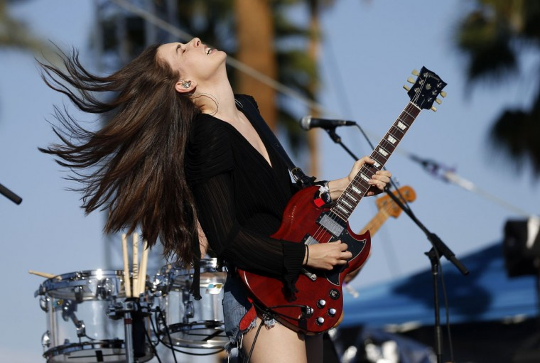 Danielle Haim of rock band Haim performs at the Coachella Music Festival in Indio, California April 11, 2014. A slew of rising artists and bands kicked off the annual Coachella Valley Music and Arts Festival on Friday, ahead of the much anticipated reunion of hip-hop duo Outkast headlining the first night of the three-day festival. (Mario Anzuoni/Reuters)