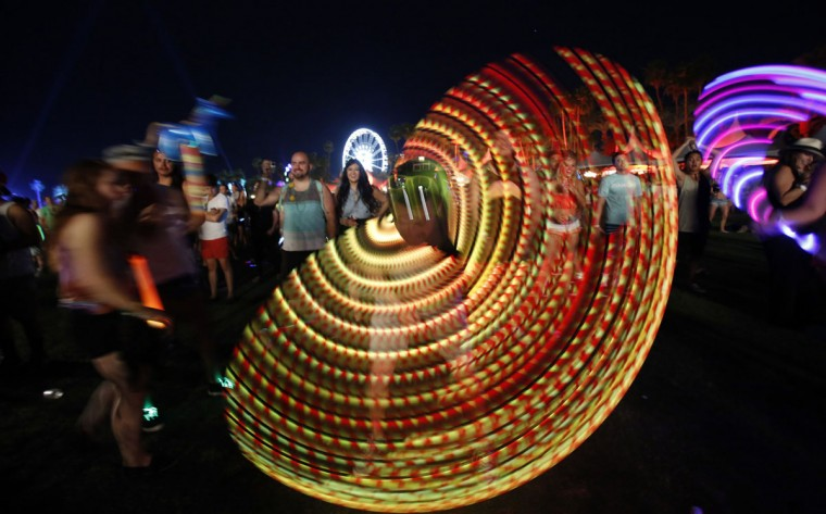 A concert-goer uses an illuminated hula hoop during the performance by Canadian electrofunk duo Chromeo at the Coachella Valley Music and Arts Festival in Indio, California April 11, 2014. (Mario Anzuoni/Reuters)