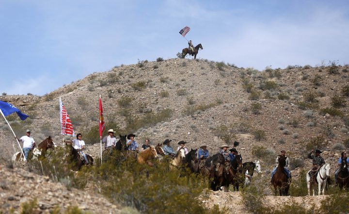 Protesters on horseback ride on the hills above a rally site in Bunkerville, Nev. Clark County Sheriff Douglas Gillespie announced the Bureau of Land Management (BLM) was ceasing its cattle roundup operation on federal lands. (Jim Urquhart/Reuters)