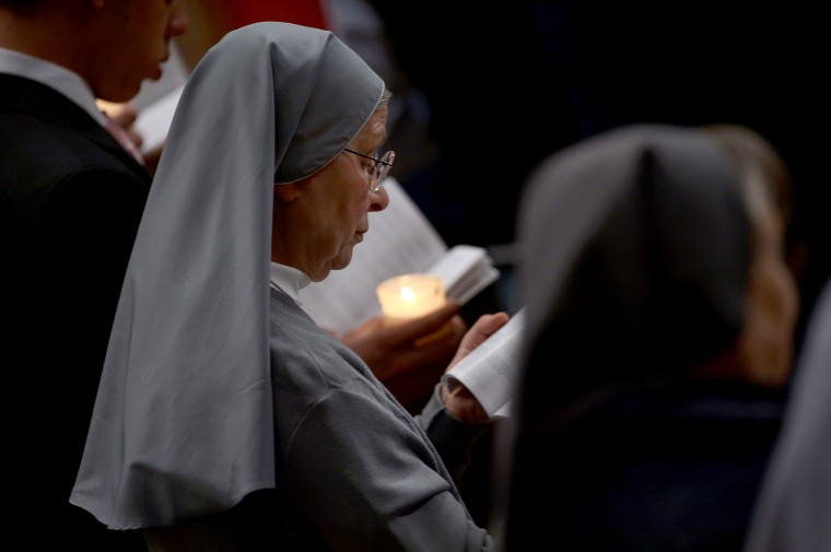 Nuns attend the Easter Vigil in St. Peter's Basilica in Vatican City. Easter Vigil, also called the Paschal Vigil, is a service held in traditional Christian churches as the first official celebration of the Resurrection of Jesus. (Filippo Monteforte/AFP/Getty Images)