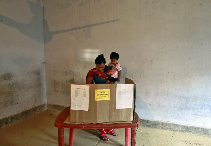 A woman with her child casts her vote at a Dhalai district polling station in the northeastern Indian state of Tripura. The Indian elections are a mammoth exercise which concludes May 12 and results due May 16. (Jayanta Dey/Reuters)