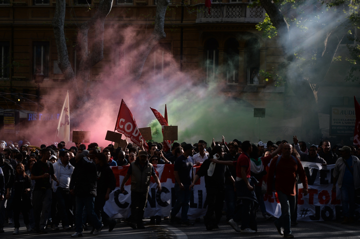 Demonstrators against austerity measures march in Rome. The procession made its way peacefully through central Rome until a more violent element wearing helmets started throwing objects at police near the Labor Ministry. (Filippo Monteforte/AFP/Getty Images)