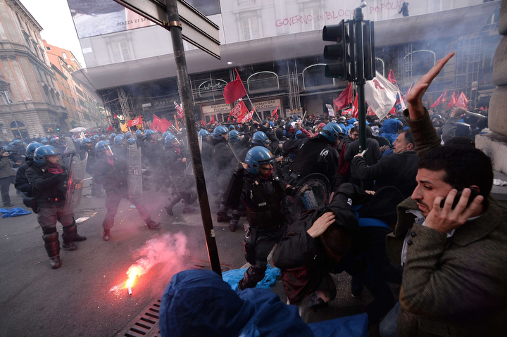 Police clash with protesters as an anti-austerity demonstration in Rome turns violent. The protest, made up of workers, students, and anti-austerity campaigners, started peacefully but turned violent when they reached the Department for Industry in the heart of the city. (Filippo Monteforte/AFP/Getty Images)