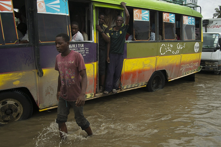 A dala-dalabus on flooded Old Bagamoyo Road pass a pedestrian in Dar es Salaam, Tanzania. Tanzania Meteorological Agency has issued a weather warning, predicting several more days of heavy rain for the coastal and southern parts of the country.(Daniel Hayduk/AFP/Getty Images)