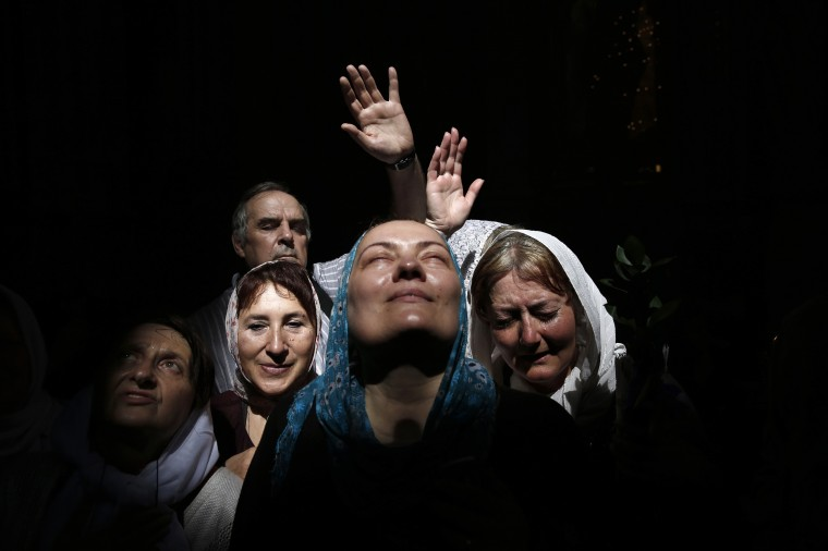 A beam of sunlight engulfs worshippers they take part in the Christian Orthodox Holy Fire ceremony at the Church of the Holy Sepulchre in Jerusalem's Old City. (Finbarr O'Reilly/Reuters)