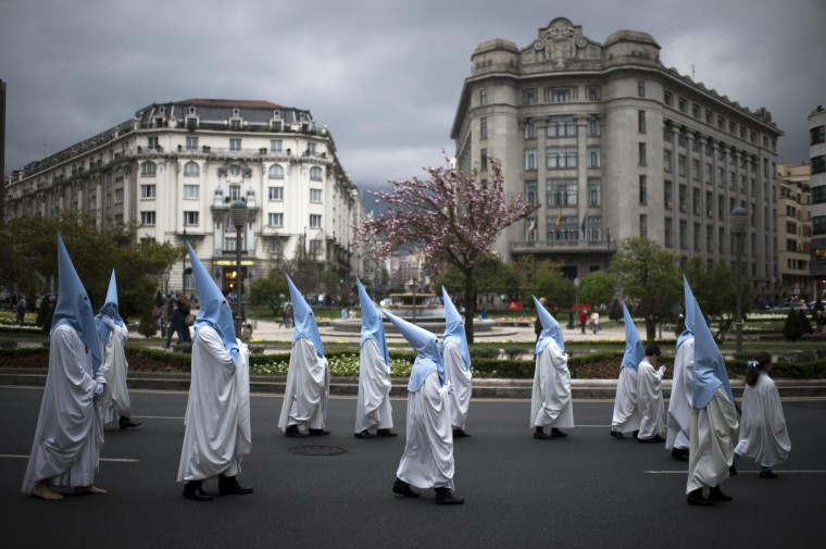 Penitents take part in the Procesion de la Esperanza in Bilbao April 19, 2014. Hundreds of Easter processions take place around the clock in Spain during Holy Week, drawing thousands of visitors. (Vincent West/Reuters)