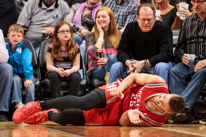 Houston Rockets forward Chandler Parsons (25) lies on the floor in the third quarter of the Rockets game against the Minnesota Timberwolves at Target Center. The Timberwolves won 112-110. (Brad Rempel/USA Today Sports)