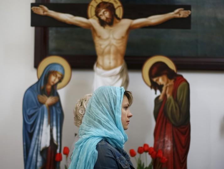 A Ukrainian Orthodox worshipper visits a church before an Easter service in the eastern Ukrainian town of Slaviansk(Gleb Garanich/Reuters)