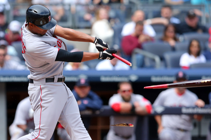 Boston Red Sox shortstop Xander Bogaerts (2) hits a broken-bat single against the New York Yankees during the second inning of their game at Yankee Stadium. (Brad Penner/USA Today Sports)