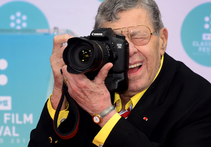 Comedian and actor Jerry Lewis photographs the working press during a ceremony outside the TCL Theater in Hollywood. He is best known for his slapstick humor in film, television and stage. (Frederic J. Brown/AFP/Getty Images)