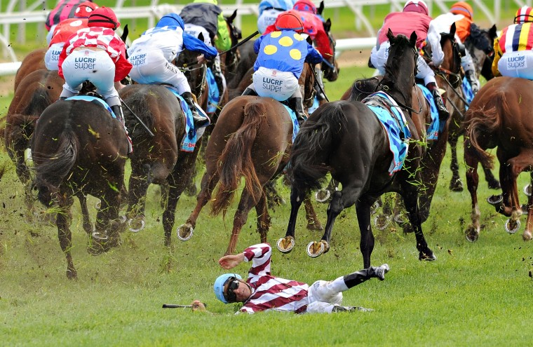 Vlad Duric escapes serious injury after falling off Golfing in in the home straight in Race 5, the Bert Bryant Handicap during Melbourne Racing at Caulfield Racecourse in Melbourne, Australia. Duric walked away with a minor leg injury. (Vince Caligiuri/Getty Images)