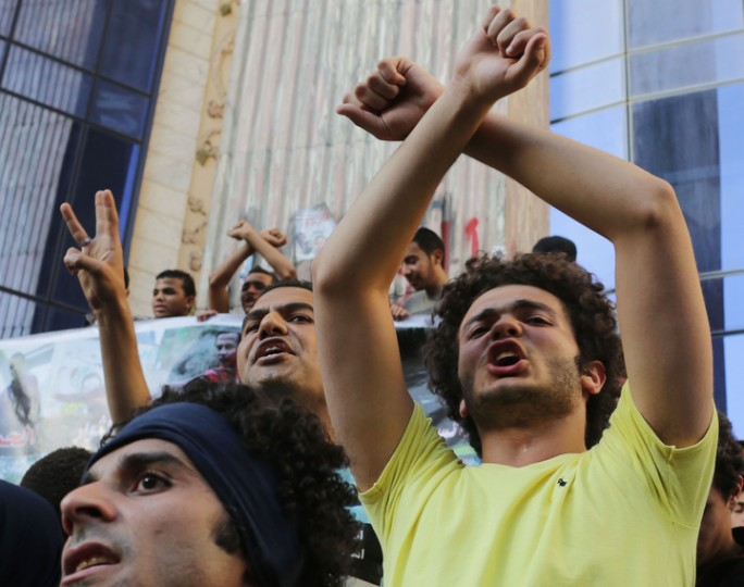 """Protesters from the '""""6th of April'' group and other opposition activists chant slogans after taking part in a """"Freedom marathon.'' The group was calling for the release of detained activists in Cairo. (Asmaa Waguih/Reuters)"""