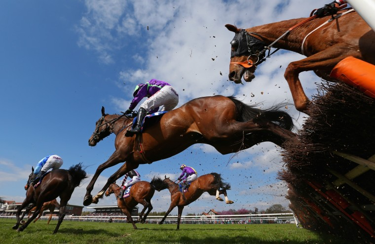 Horses race during The £3 Million totescoop6 Today Handicap Hurdle Race at Haydock Racecourse on April 19, 2014 in Haydock, England. (Alex Livesey/Getty Images)