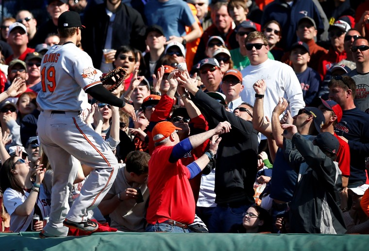 Baltimore Orioles first baseman Chris Davis (19) chases a foul ball into the crowd during the sixth inning against the Boston Red Sox at Fenway Park. (Greg M. Cooper/USA Today Sports)