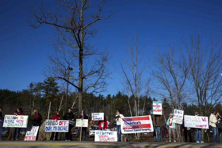 Protestors stand on the side of a road outside of the inaugural Freedom Summit meeting for conservative speakers in Manchester, N.H. (Lucas Jackson/Reuters)