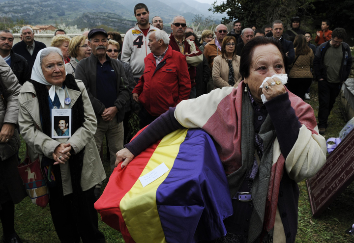 Juana Gutierrez carries flag-draped remains of her grandfather, a victim of Spain's Civil War, in the cemetery of Valdenoceda, near Burgos, northern Spain. The remains of 23 victims executed by Francisco Franco's regime during the Spanish Civil War were exhumed from mass graves from the Spanish Civil War. (Eloy Alonso/Reuters)